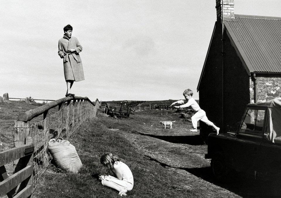 Paul playing with his children Stella and James at the family's farm in Scotland in 1982.
