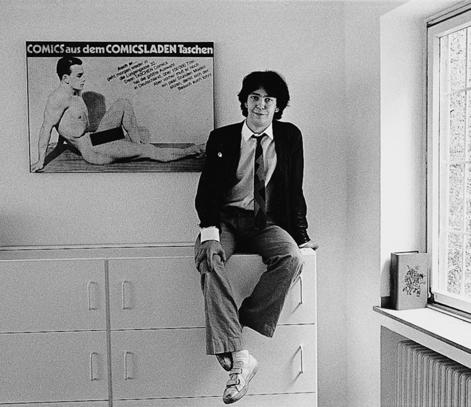 Benedikt Taschen poses for Der Spiegel in front of one of his posters