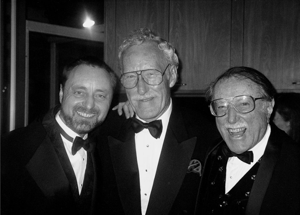 Frans Lanting, Bill Claxton, and Julius Shulman celebrate at the Giants of the Camera party at the Chemosphere House, Hollywood, 1999.