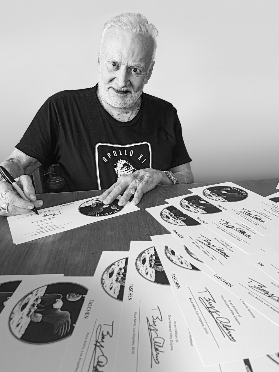 Astronaut Buzz Aldrin signs special edition NASA prints.